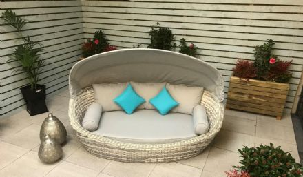 Constantine Oval daybed with hood in Silver Grey wicker with Pale Grey cushions
